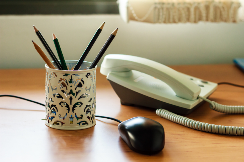 Office supplies, gadgets and pencil set on wooden table